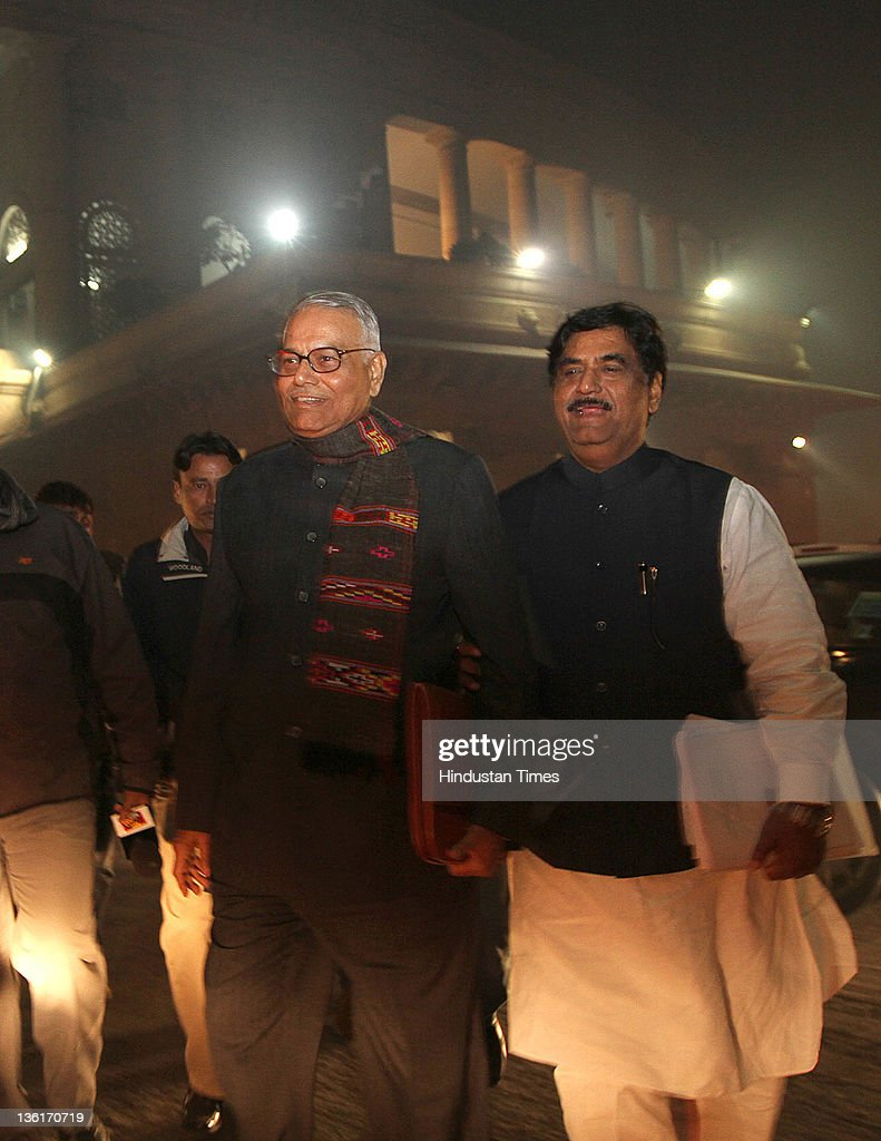 BJP leaders <a gi-track='captionPersonalityLinkClicked' href=/galleries/search?phrase=Yashwant+Sinha&family=editorial&specificpeople=227891 ng-click='$event.stopPropagation()'>Yashwant Sinha</a> and <a gi-track='captionPersonalityLinkClicked' href=/galleries/search?phrase=Gopinath+Munde&family=editorial&specificpeople=652850 ng-click='$event.stopPropagation()'>Gopinath Munde</a> come out after the voting on Lokpal Bill in Lok Sabha at Parliament house on December 27, 2011 in New Delhi, India. The Lokpal bill was passed by voice vote with 10 amendments, however the Left parties, SP and BSP walked out in protest before the voting.