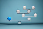 Leadership balancing the team - sphere in balance. This is a 3d render illustration