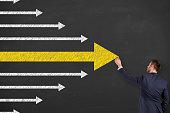 Leadership Concept Arrows on Chalkboard Background