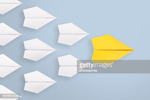 Leadership concepts with yellow paper plane leading among white : Foto stock