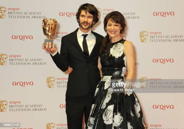 Leading Actor winner Ben Whishaw and Helen McCrory pose in the press room at the Arqiva British Academy Television Awards 2013 at the Royal Festival...