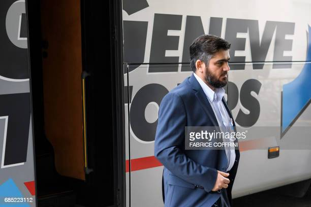 Leading figure of the Jaish alIslam rebel group and member of the High Negotiations Committee Mohammed Alloush arrives for a meeting with UN's...