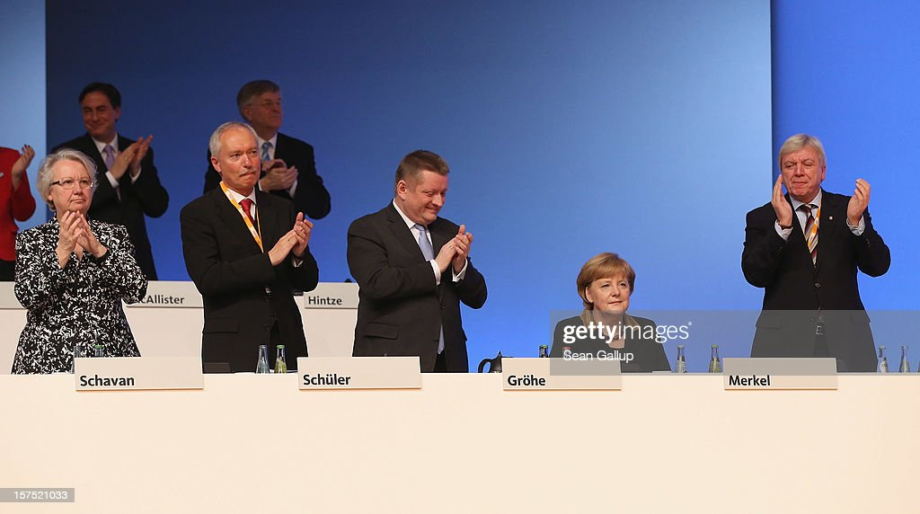 Leading members of the German Christian Democratic Union (CDU) applaud German Chancellor and CDU Chairwoman Angela Merkel (seated) after she spoke at the CDU federal party convention on December 4, 2012 in Hanover, Germany. The CDU has a strong lead over its opponents though has recently lost the mayoral posts in several major German cities to opposition parties. Germany faces federal elections in 2013.