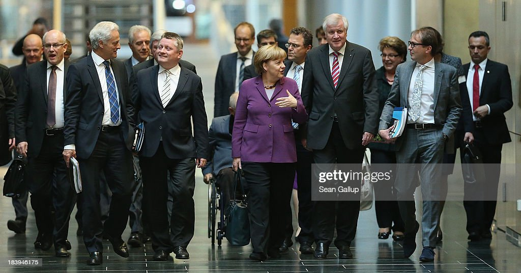 Leading members of the German Christian Democrats (CDU), including Chancellor <a gi-track='captionPersonalityLinkClicked' href=/galleries/search?phrase=Angela+Merkel&family=editorial&specificpeople=202161 ng-click='$event.stopPropagation()'>Angela Merkel</a> (C), as well as <a gi-track='captionPersonalityLinkClicked' href=/galleries/search?phrase=Horst+Seehofer&family=editorial&specificpeople=4273631 ng-click='$event.stopPropagation()'>Horst Seehofer</a> (R of Merkel), Chairman of the bavrian Christian Democrats (CSU), arrive for talks over a possible government coalition with the German Greens Party (Buendnis 90/Die Gruenen) on October 10, 2013 in Berlin, Germany. The CDU, together with the CSU, finished recent federal elections with a strong lead but is seeking a coalition partner in order to form a majority government coalition.