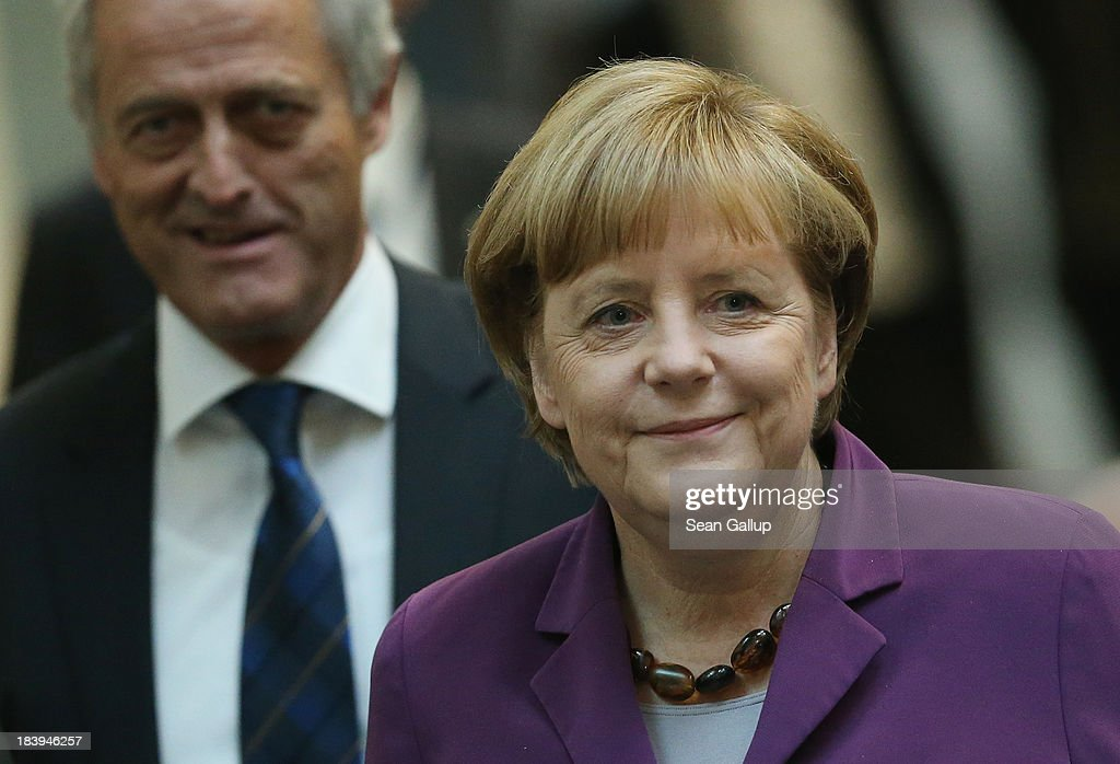 Leading members of the German Christian Democrats (CDU), including Chancellor Angela Merkel and Transport Minister <a gi-track='captionPersonalityLinkClicked' href=/galleries/search?phrase=Peter+Ramsauer&family=editorial&specificpeople=770626 ng-click='$event.stopPropagation()'>Peter Ramsauer</a>, arrive for talks over a possible government coalition with the German Greens Party (Buendnis 90/Die Gruenen) on October 10, 2013 in Berlin, Germany. The CDU, together with the CSU, finished recent federal elections with a strong lead but is seeking a coalition partner in order to form a majority government coalition.