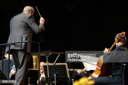 Leading the orchestra in a symphony