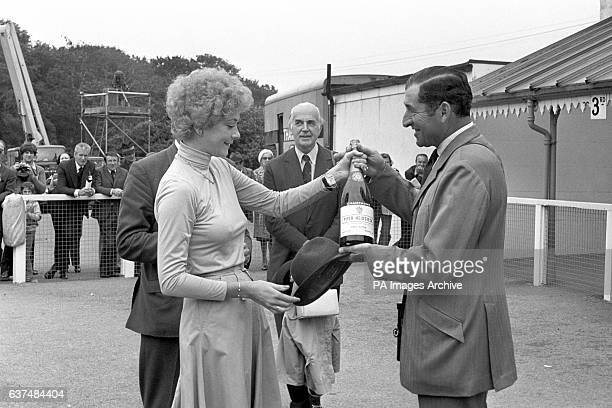 Leading trainer Dick Hern is presented with a magnum of champagne from actress Linda Thorson