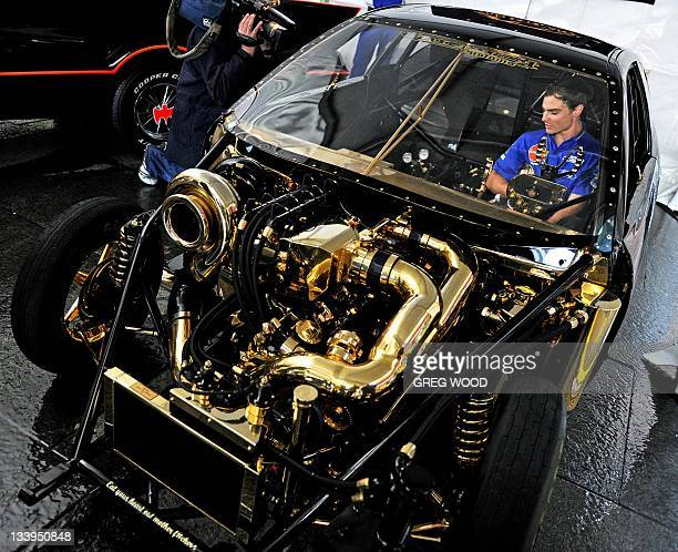 Leading V8 Supercar driver Tim Slade sits in a goldplated BMW drag car known as 'Goldie Horn' which boasts the highest torque rotary engine in the...