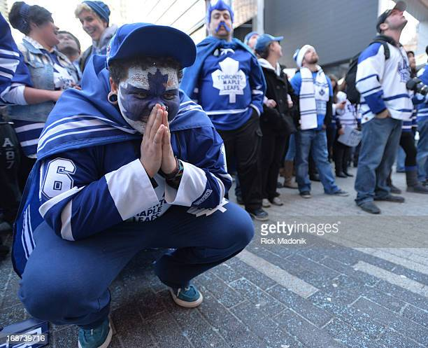 Leaf fan is dejected after Boston scores the first goal in 1st period Toronto Maple Leaf fans react to the Game 7 action in Boston between Toronto...