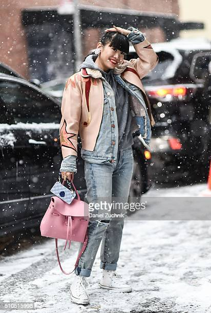 Leaf Greener is seen outside the Thom Browne show wearing a brown jacket blue jeans and a pink bag during New York Fashion Week Women's Fall/Winter...