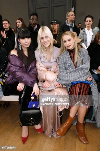 Leaf Greener Linda Tol and Sofia Macks attend the Nina Ricci show as part of the Paris Fashion Week Womenswear Fall/Winter 2017/2018 on March 4 2017...