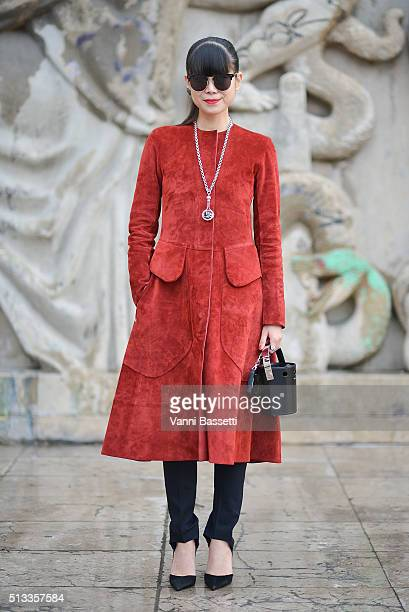 Leaf Greener poses wearing an Hermes coat and Perrin bag before the Rochas show at the Palais de Tokyo during Paris Fashion Week FW 16/17 on March 2...