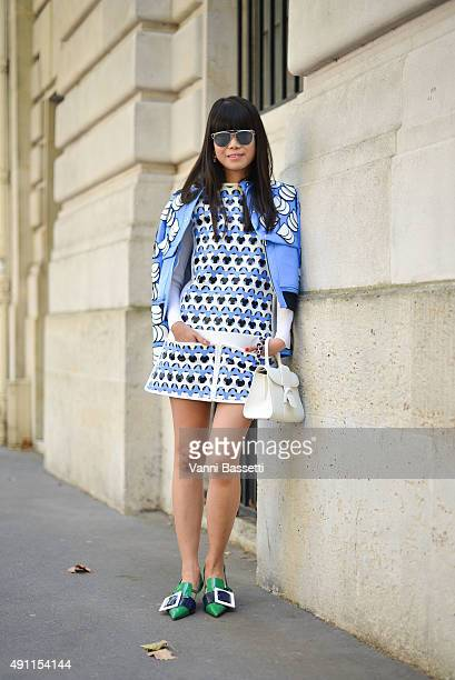 Leaf Greener poses wearing Courreges dress Dior bag and Miu Miu shoes before the Acne Studios show at the Hotel Potocki during Paris Fashion Week...