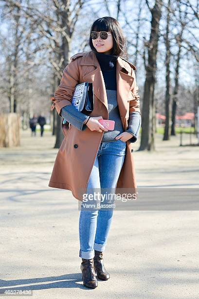 Leaf Greener poses wearing Louis Vuitton coat and Shoes CK jeans and Yaz Bukey clutch on Day 3 of Paris Fashion Week Womenswear FW15 on March 5 2015...