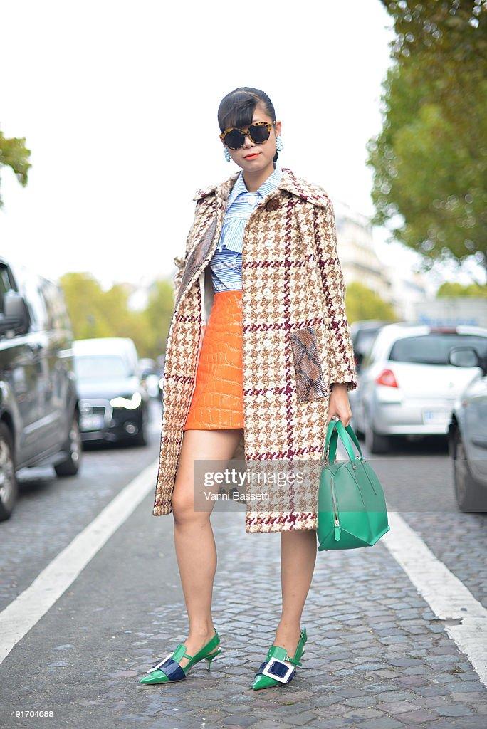 Leaf Greener poses wearing Miu Miu and Delpozo bag before the Miu Miu show at the Palais de Iena during Paris Fashion Week SS16 on October 7 2015 in...