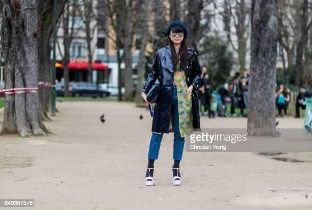 Leaf Greener wearing a black coat outside Moncler on March 7 2017 in Paris France