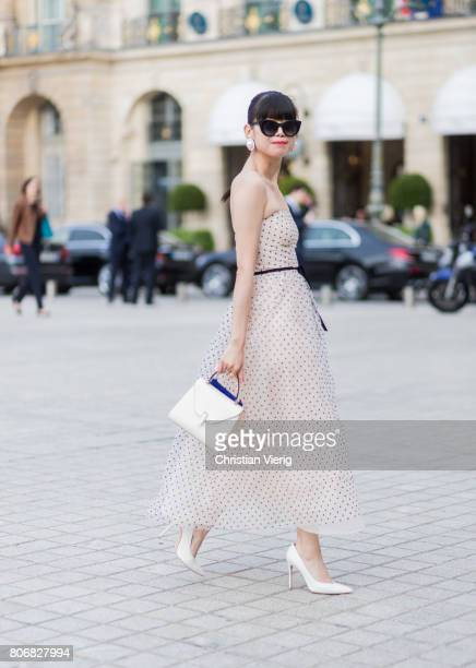 Leaf Greener wearing a dress outside Schiaparelli during Paris Fashion Week Haute Couture Fall/Winter 20172018 Day Two on July 3 2017 in Paris France