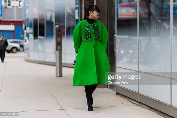 Leaf Greener wearing a green wool coat seen outside Delpozo during New York Fashion Week Women's Fall/Winter 2016 on February 17 2016 in New York City
