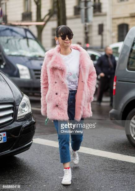 Leaf Greener wearing a pink coat white shirt denim jeans outside Rochas on March 1 2017 in Paris France