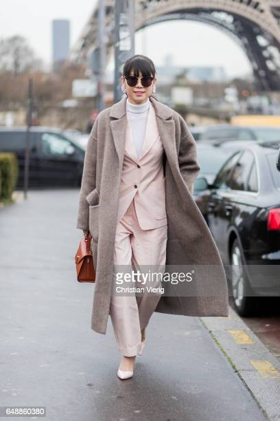 Leaf Greener wearing a wool coat pastel suit outside Hermes on March 6 2017 in Paris France