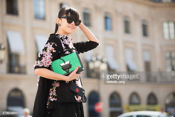 Leaf Greener wears a Romance Was Born dress AM Eyewear sunglasses and a Loewe bag at the Schiaparelli show at Hotel d'evreux on July 6 2015 in Paris...