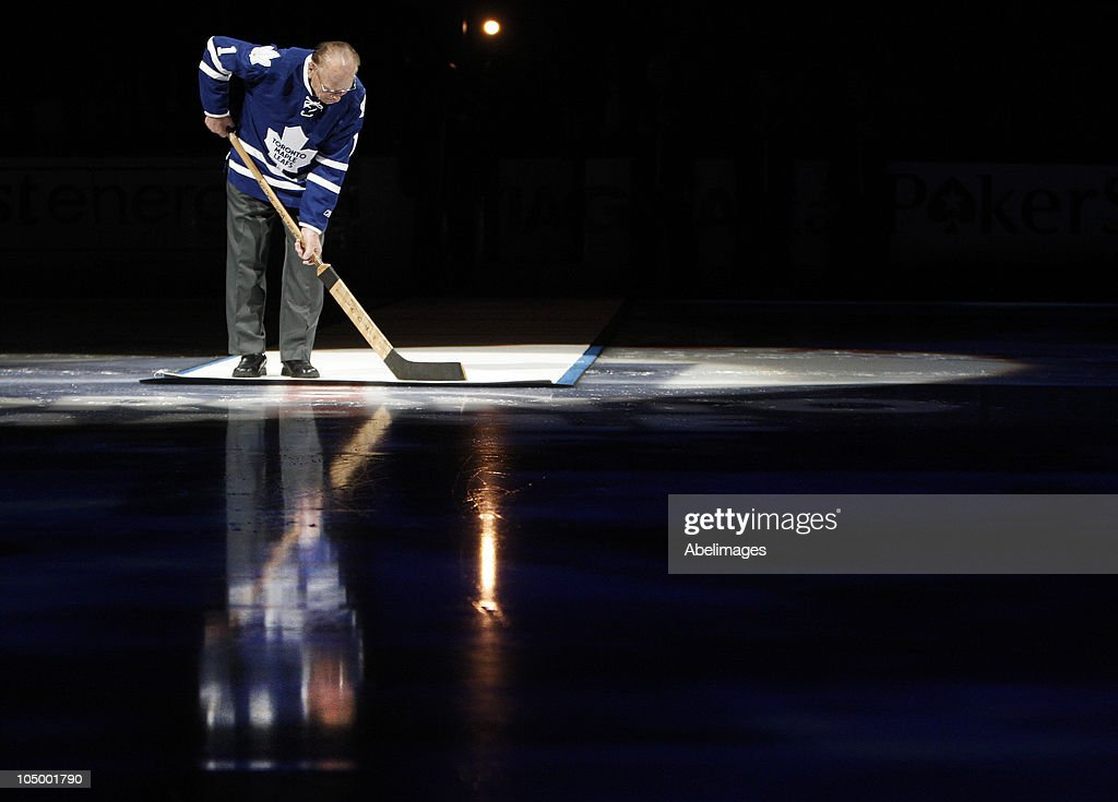 Leaf Hall of Famer Johnny Bower take part in the pre-game ceremony before the Toronto Maple Leafs take on the Montreal Canadiens during a regular season NHL game against the Toronto Maple Leafs at the Air Canada Centre October 7, 2010 in Toronto, Ontario, Canada.