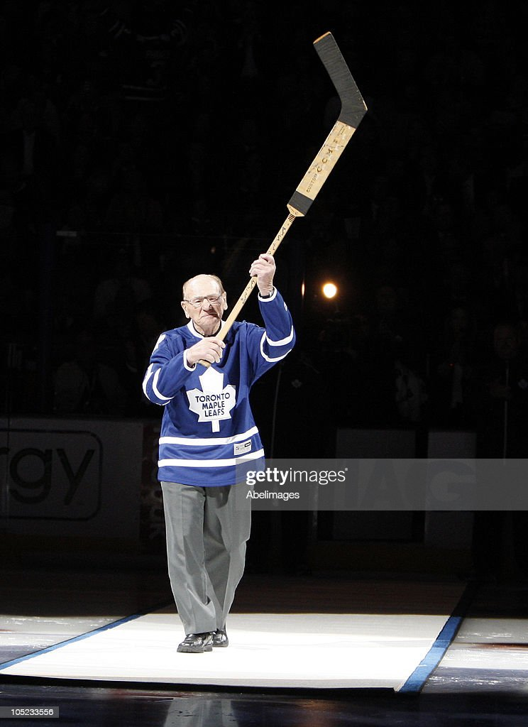 Leaf Hall of Famer <a gi-track='captionPersonalityLinkClicked' href=/galleries/search?phrase=Johnny+Bower&family=editorial&specificpeople=239053 ng-click='$event.stopPropagation()'>Johnny Bower</a> take part in the pre-game ceremony before the Toronto Maple Leafs take on the Montreal Canadiens during a regular season NHL game at the Air Canada Centre October 7, 2010 in Toronto, Ontario, Canada.