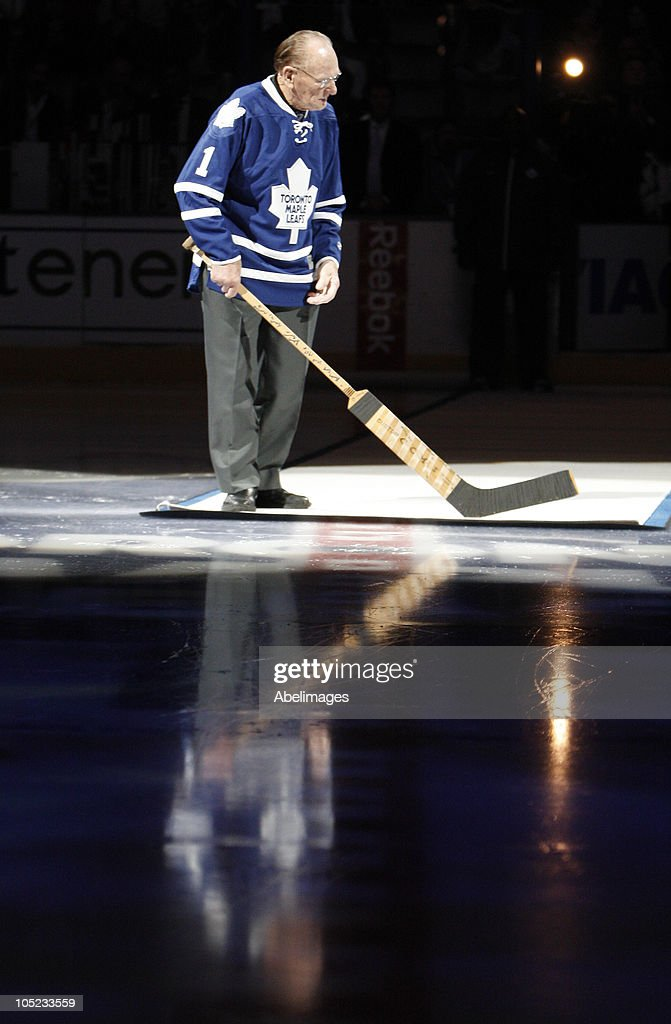 Leaf Hall of Famer Johnny Bower take part in the pre-game ceremony before the Toronto Maple Leafs take on the Montreal Canadiens during a regular season NHL game at the Air Canada Centre October 7, 2010 in Toronto, Ontario, Canada.