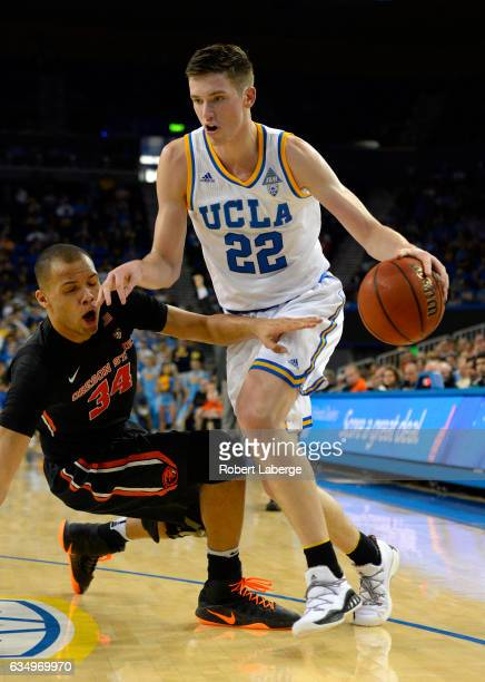 Leaf of the UCLA Bruins attacks the basket against Ben Kone of the Oregon State Beavers at Pauley Pavilion on February 12 2017 in Los Angeles...