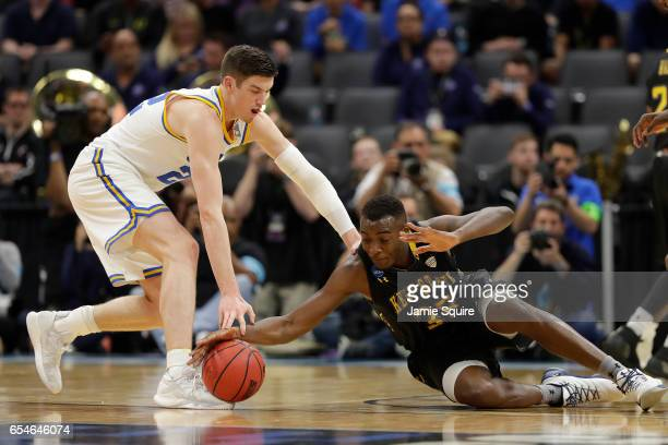 Leaf of the UCLA Bruins battles for the ball with Jimmy Hall of the Kent State Golden Flashes during the first round of the 2017 NCAA Men's...