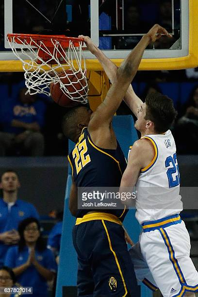 J Leaf of the UCLA Bruins dunks the ball against Kingsley Okoroh of the California Golden Bears in the last few minutes during the game against the...