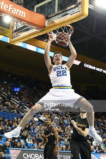 Leaf of the UCLA Bruins dunks the ball in the first period against the Long Beach State 49ers at Pauley Pavilion on November 20 2016 in Los Angeles...