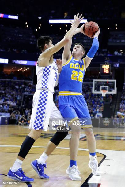 Leaf of the UCLA Bruins tries to shoot against Derek Willis of the Kentucky Wildcats in the first half during the 2017 NCAA Men's Basketball...