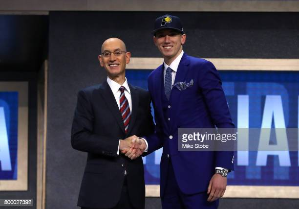 J Leaf walks on stage with NBA commissioner Adam Silver after being drafted 18th overall by the Indiana Pacers during the first round of the 2017 NBA...