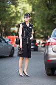 Leaf Zhang wears a Raf Simons jacket Alexander McQueen bag and Bing Xu shoes during Milan Men's Fashion Week Spring/Summer 2016 on June 20 2015 in...