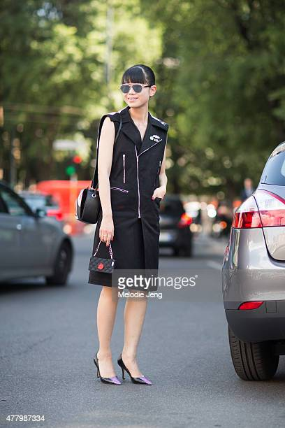Leaf Zhang wears a Raf Simons jacket Alexander McQueen bag and Bing Xu shoes during Milan Men's Fashion Week Spring/Summer 2016 on June 20 2015 in...
