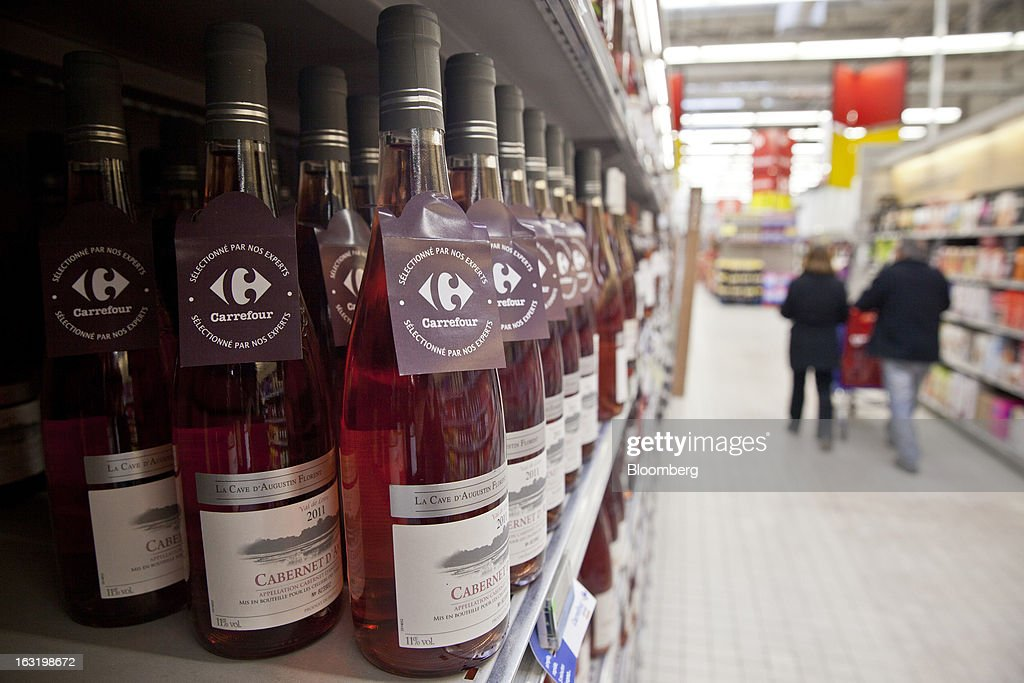A leaflet alerts customers to a Carrerfour-selected bottled of rose wine in the beers, wines and spirits department inside a Carrefour SA supermarket in Portet sur Garonne, near Toulouse, France, on Tuesday, March 5, 2013. Carrefour's stock has risen 47 percent since Georges Plassat's arrival as chief executive officer, partially offsetting a 71 percent decline in the preceding five years. Photographer: Balint Porneczi/Bloomberg via Getty Images