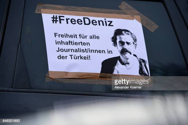 A leaflet is sticked at the side window of a car reading '#FreeDeniz Freedom for all imprisoned Journalists in Turkey' before a motorcade...