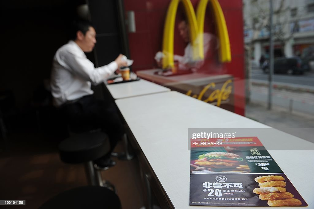A leaflet on a table in McDonald's advertises discount on chicken McNuggets at a branch in Shanghai on April 9, 2013. The Fast food giant slashed prices by more than 40 percent on a chicken item, offering 20 McNuggets for 20 yuan ($3.17) while emphasising its food was safe in a publicity campaign. AFP PHOTO/Peter PARKS