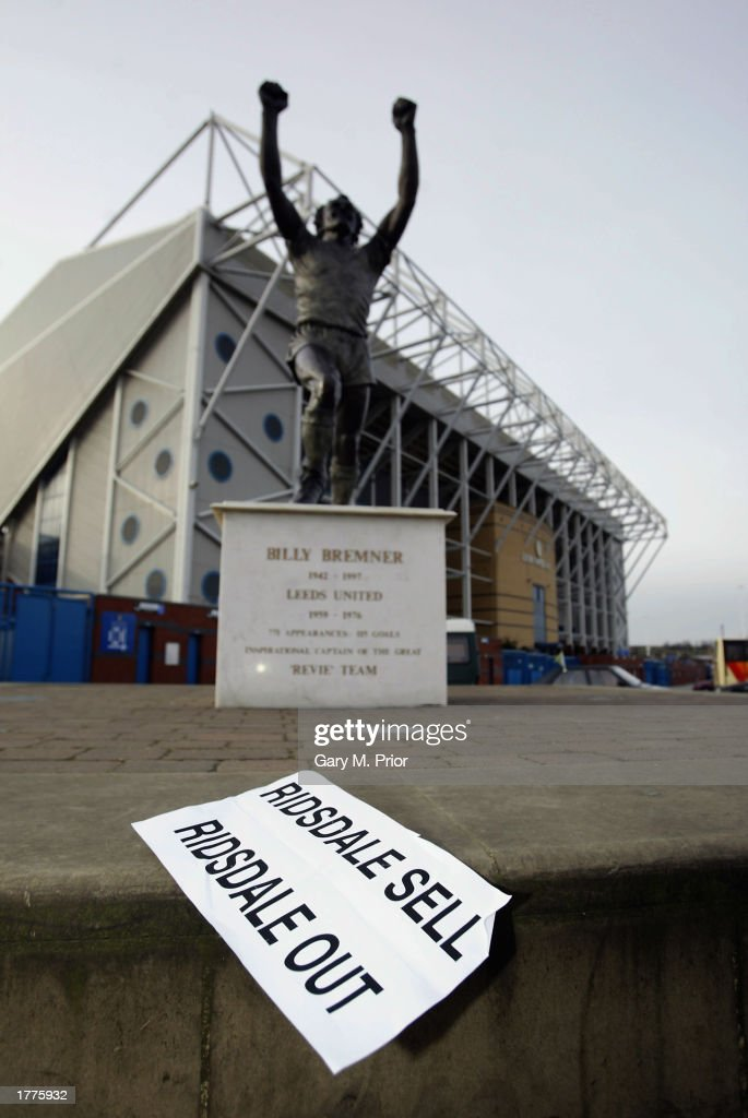 A leaflet spelling out some Leeds United fans' views blows around in front of the Billiy Bremner statue during a Leeds United press conference on January 31, 2003 at Elland Road in Leeds, England.