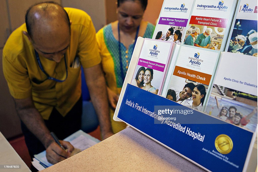 Leaflets advertising health care services stand at a service counter in the Wellness Center of the Indraprastha Apollo Hospitals facility, operated by Apollo Hospitals Enterprise Ltd., in New Delhi, India, on Wednesday, July 19, 2013. Prathap C. Reddy, the cardiologist who built the Apollo hospital chain valued at $2 billion over three decades in India, says hes seeking growth overseas as the nations visa policies drive medical tourists to rivals. Photographer: Prashanth Vishwanathan/Bloomberg via Getty Images