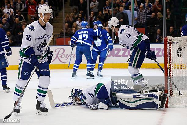 Leafs celebrate the 2nd goal as Vancouver Canucks goalie Ryan Miller lay on the ice and Vancouver Canucks right wing Jannik Hansen and Vancouver...