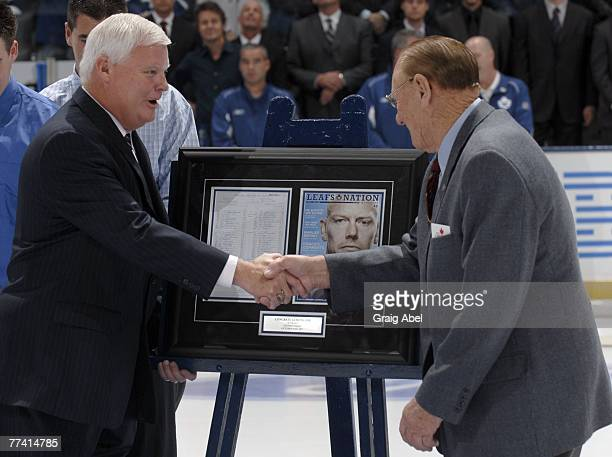 Leafs Commentator Joe Bowen is congratulated by Leaf great Johnny Bower for 25 years of service during opening ceremonies before action between the...