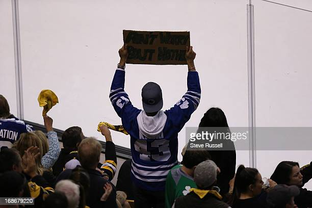 BOSTON MA MAY 13 Leafs fan watches action in the in second period action as the Toronto Maple Leafs play the Boston Bruins in game 7 in their first...