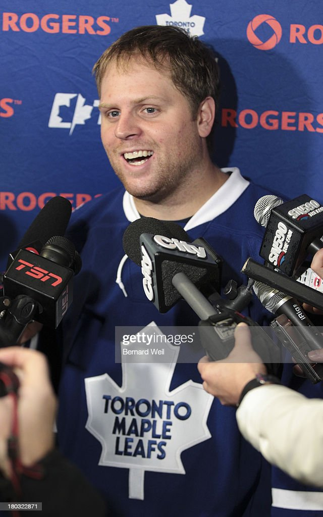TORONTO, ON - SEPTEMBER 11 - Leafs' Phil Kessel is all smiles in a scrum with media during the opening of Toronto Maple Leafs camp, at the Mastercard Centre. September 11, 2013.