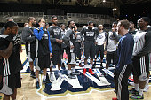 League AllStar players gather for a meeting on the court during practice at the 2014 NBA AllStar Jam Session at the Ernest N Morial Convention Center...