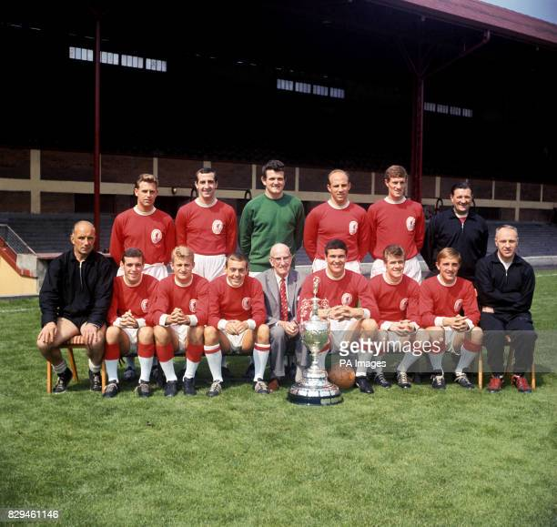 League champions Liverpool pose with the trophy Gordon Milne Gerry Byrne Tommy Lawrence Ronnie Moran Wilf Stevenson trainer Bob Paisley trainer...