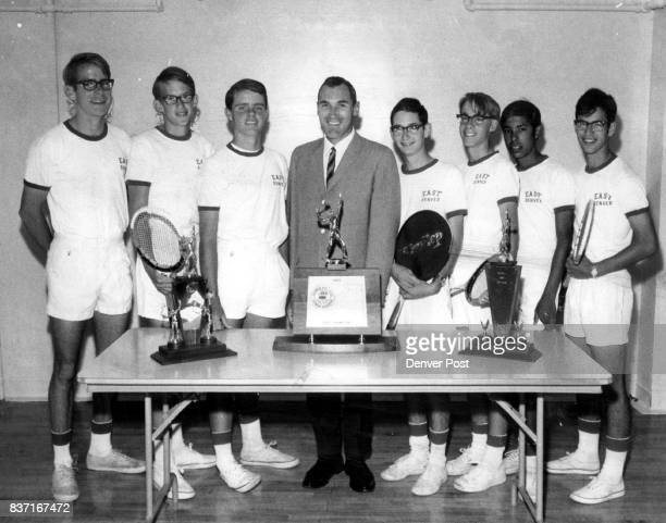 League District and State Tennis Trophies in Singer Year Members of East High School grandslam team are left to right Matt Jackson Dave Greene Mike...