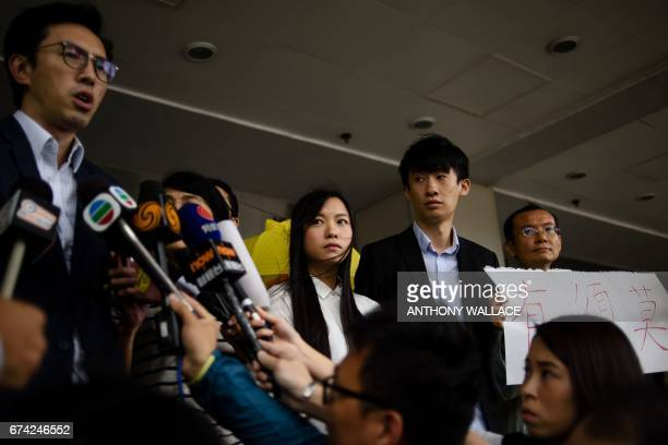 CORRECTION League of Social Democrats lawmaker Avery Leung speaks as Hong Kong independence activists Yau Waiching and Baggio Leung stand outside the...
