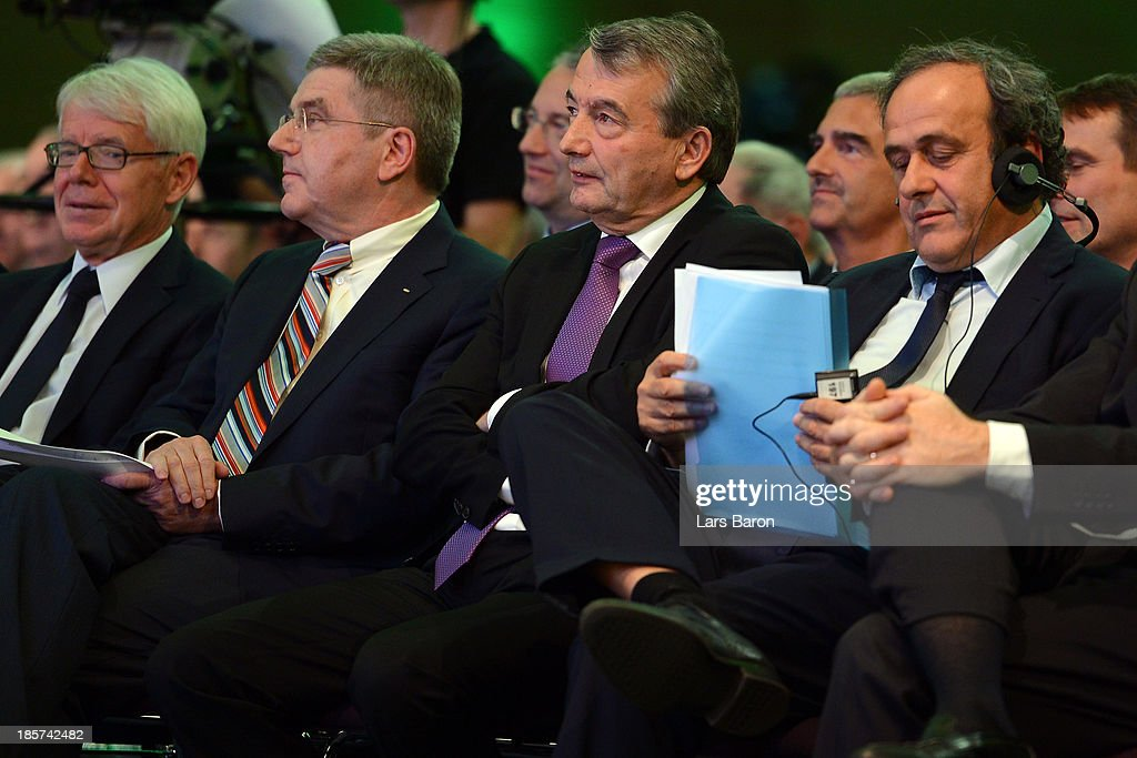 League President <a gi-track='captionPersonalityLinkClicked' href=/galleries/search?phrase=Reinhard+Rauball&family=editorial&specificpeople=652253 ng-click='$event.stopPropagation()'>Reinhard Rauball</a>, IOC president Dr. <a gi-track='captionPersonalityLinkClicked' href=/galleries/search?phrase=Thomas+Bach&family=editorial&specificpeople=610149 ng-click='$event.stopPropagation()'>Thomas Bach</a>, UEFA president <a gi-track='captionPersonalityLinkClicked' href=/galleries/search?phrase=Michel+Platini&family=editorial&specificpeople=206862 ng-click='$event.stopPropagation()'>Michel Platini</a> listen to the a speech during the DFB Bundestag at the NCC Nuremberg on October 24, 2013 in Nuremberg, Germany.